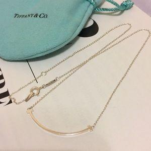 Tiffany & Co mini T smile pendant